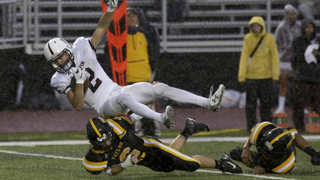 Turpin junior Luke Bohenek spent more time on his feet than his back as he rushed for 226 yards and two touchdowns as the Spartans beat Taylor 35-13 Friday night.