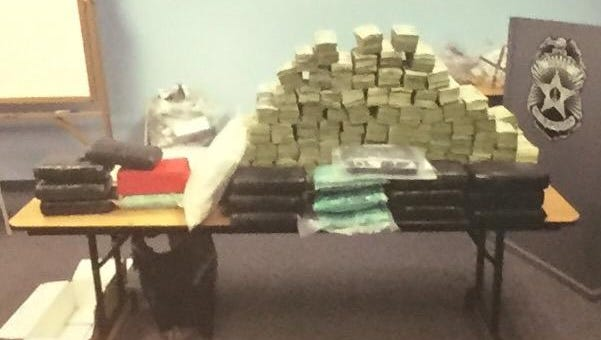 Authorities display items seized.