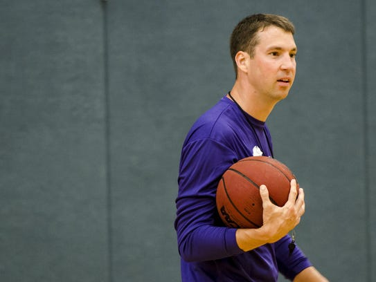 FSW men's basketball coach Marty Richter works with