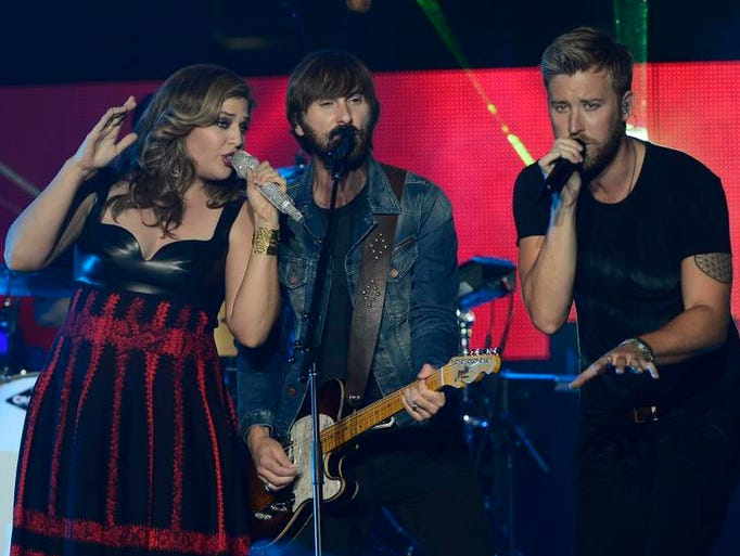 Lady Antebellum performs on an outdoor stage during the CMT Music Awards on Wednesday, June 4, 2014, in Nashville, Tenn.