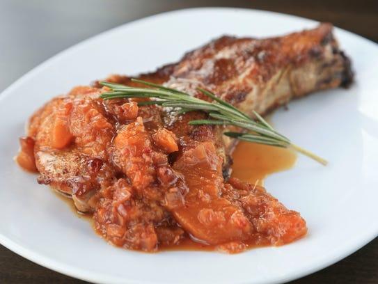 Cumin and coriander-dusted pork chop with peach chutney from Gander ...