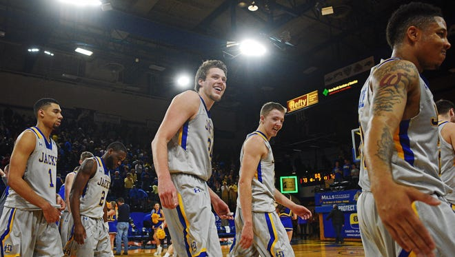 SDSU players, including Mike Daum and Reed Tellinghuisen exit the court after their 73-72 win over USD during a game Saturday, Dec. 31, 2016, at Frost Arena on the South Dakota State University campus in Brookings, S.D.