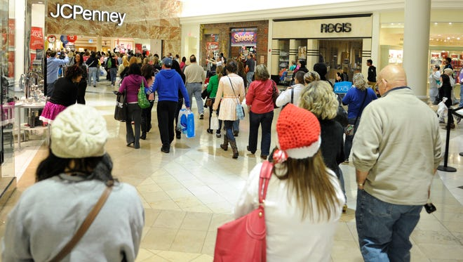 Shoppers pour through West Town Mall in Knoxville for Black Friday deals on Nov. 23, 2012.
