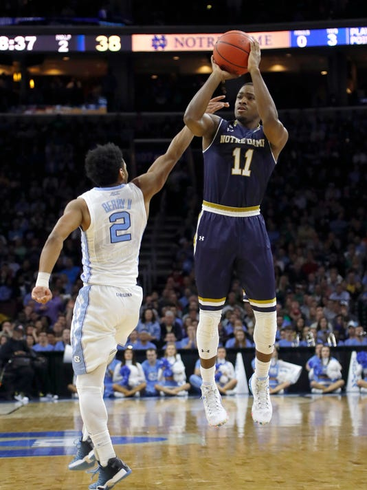 Notre Dame's Demetrius Jackson, right, goes up for a shot against North Carolina's Joel Berry II during the second half of a regional final men's college basketball game in the NCAA Tournament, Sunday, March 27, 2016, in Philadelphia. (AP Photo/Matt Rourke)