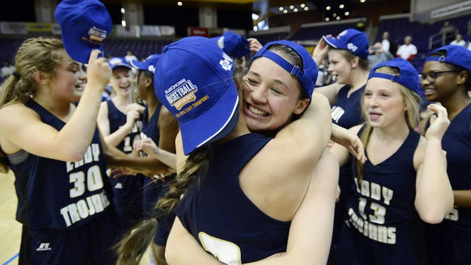 Northpoint Christian players celebrate their 63-42 win over Knoxville Webb in the Tennessee Division II A girls high school basketball championship game on Saturday, March 5, 2016, in Nashville, Tenn. (AP Photo/Mark Zaleski)