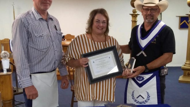 """On July 2nd, 2020, Paint Rock Masonic Lodge # 613  was honored to present the Community Builder Award to Mrs. Kerrie Collins of Paint Rock for her many contributions and service to her Community. Pictured L to R, Micky Collins, Kerrie Collins (recipient), and WM Ricky Donaldson, Master of the Lodge."""""""