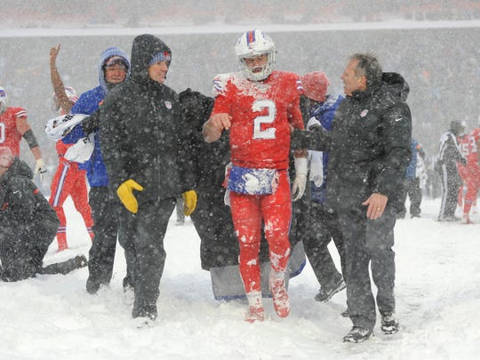 Buffalo Bills quarterback Nathan Peterman is helped to the sidelines during the second half of an NFL football game against the Indianapolis Colts, Sunday, Dec. 10, 2017, in Orchard Park, N.Y. (AP Photo/Adrian Kraus)