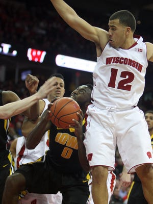 Iowa Hawkeyes center Gabriel Olaseni (0) looks to shoot as Wisconsin guard Traevon Jackson (12) defends during the first half of a game last season.