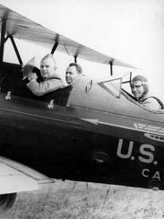 Governor Doyle Carlton, center, in a plane at the grand