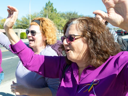 """New Mexico State University professor of art history Elizabeth Zarur, right, chants during a political protest on Monday, November, 14, 2016, in front of the NMSU Art Gallery. Zarur said the idea for the event started in one of her classes last Thursday, """"My students were very upset after the election,"""" said Zarur. Standing next to Zarur is one of her students, Bernadette Larimer."""