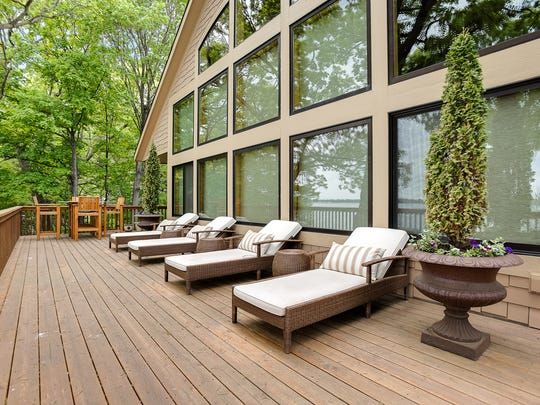 The home's lakeside-facing deck is longer than the house itself.
