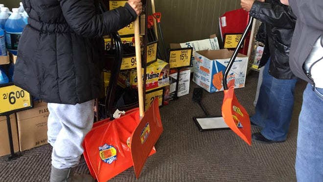 Shoppers at Safeway in Bowie, Md., stock up on snow shovels on Jan. 20, 2016.