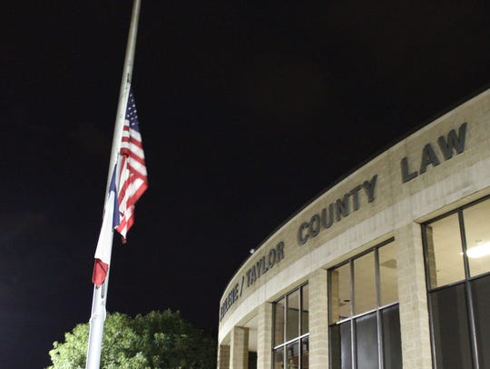 The flag outside the Law Enforcement Center flies at