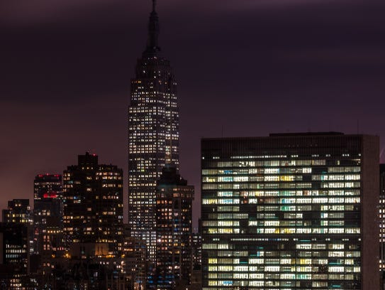 The Empire State Building dimmed its tower lights Nov.