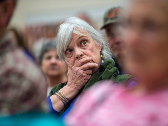 Essie Howe listens to a debate over a motion requiring presidential candidates to release their tax returns in order to appear on the Vermont primary ballot during Underhill's town meeting at the Browns River Middle School in Jericho on Tuesday, March 7, 2017. The motion failed.