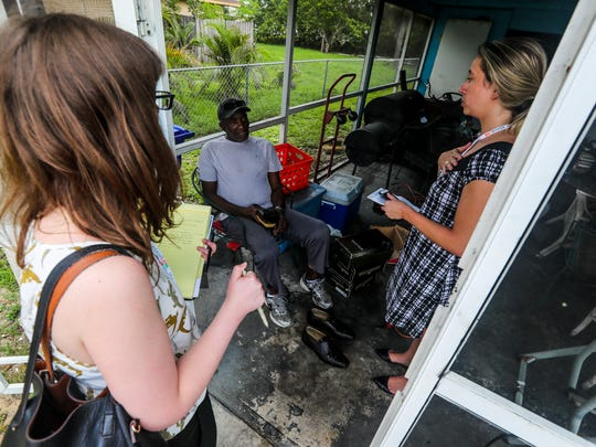 Abigail Fleming and Lauren Oswald, law students from University of MiamiÕs Environmental Justice Clinic, speak with Dunbar resident, Sammy Jackson, about living near Home-a-rama. The University of Miami Law students hit the Dunbar streets this morning after breakfast at a Fort Myers icon, the FarmerÕs Market to gather resident histories around the toxic dump site known by the city and Department of Environmental protection as Home-a-rama. As well as document what they could see of the site itself.