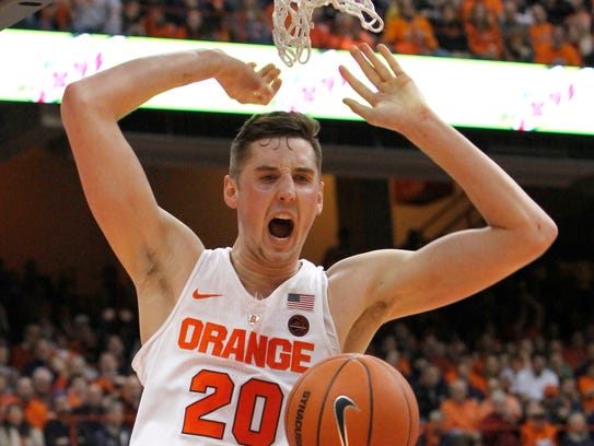 Syracuse's Tyler Lydon yells after dunking the ball
