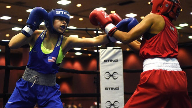 Heaven Garcia, left, from El Monte, Calif., connects with a jab against Nicole Aviles to win the 106 lbs Junior female bout during the USA Boxing Junior Open and Youth National Championships at the Grand Sierra Resort in Reno on Jan. 9, 2016.