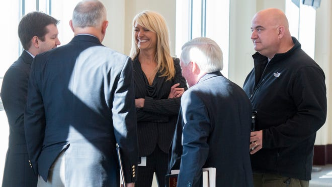 Assistant District Attorney Jan Norman, center, speaks with attorney Alex Little, far left, and Metro police detective Chad Gish, far right, after a hearing at the Justice A.A. Birch Building on Tuesday in Nashville.