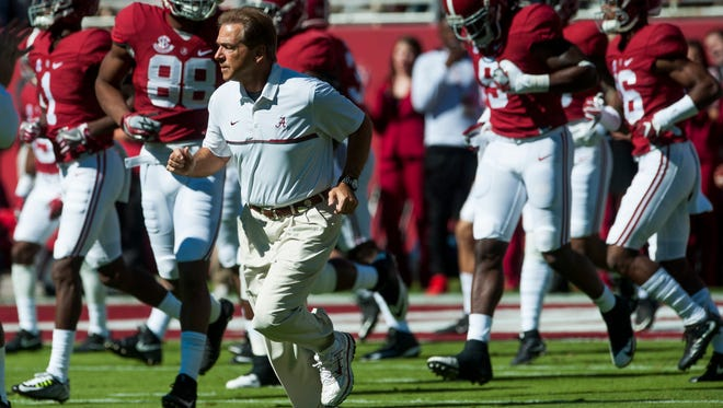 Alabama head coach Nick Saban runs onto the field for warmups before the Texas A&M game at Bryant-Denny Stadium in Tuscaloosa on Saturday, October 22, 2016.