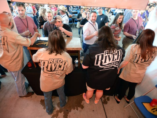 Patrons line up to sample the beers from Red River