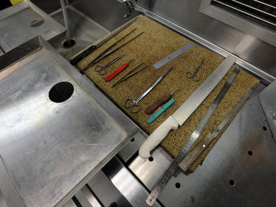 Clean tools are kept close by if an autopsy needs to