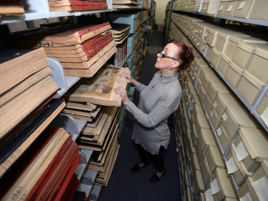 Laura McLeMore checks a bound book of old Shreveport Times papers stored at the LSUS Archive. A leaking roof in a nearby office has caused concern with the staff on the safety of their archives.LSUS Archive