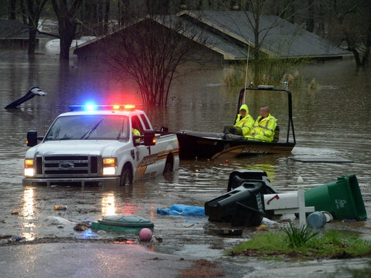 Bossier Parish Sherrif's deputies take a search boat out along Whispering Pine Drive in the Tall Timbers subdivision to search for people stranded in their homes. Heavy rains inundated NWLA Tuesday evening and is expected to produce more rain untill Thursday.