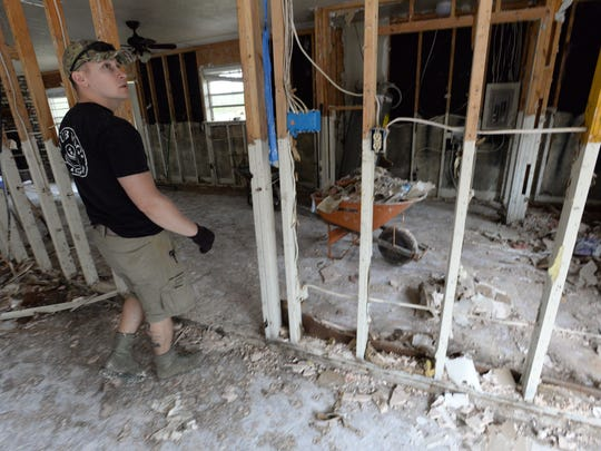Rick Saathoff looks over the interior of his home in