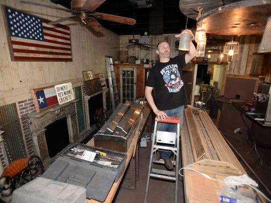 Weston McElwee, owner of Tejas works in his restaurant