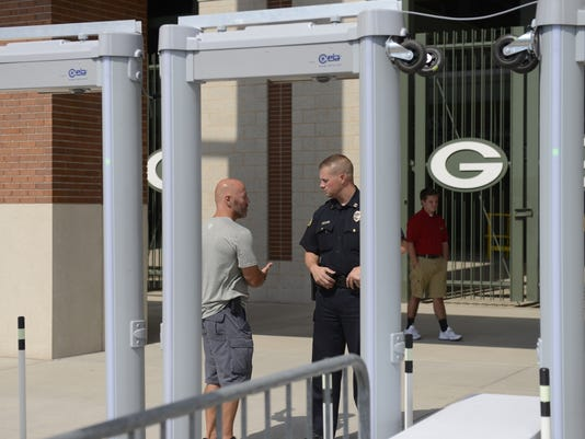 Doug Collins, Green Bay Packers, and Kevin Warych, Green Bay Police Department