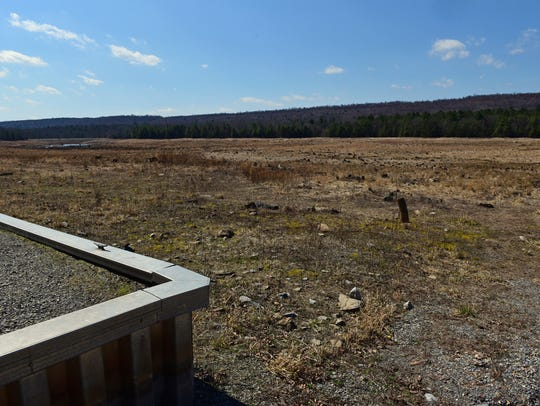 The former Meadow Grounds Lake, seen March 22, was