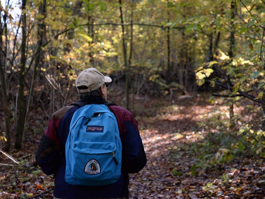 Dolly McNulty, creator of the Ice Age Trail Alliance ColdCache program walks along the Trail in Point Beach State Forest. Her backpack is one of the ColdCache Park Packs, loaded with a GPS unit and directions on how to verify your ColdCache find.
