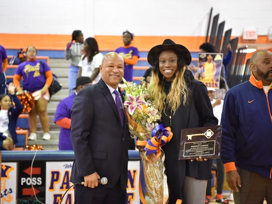 Paterson native Essence Carson, who was a star player for Rutgers and the WNBA's NY Liberty and now with the Los Angeles Sparks,, receives the key to the city of Paterson from Assemblyman Benjie E. Wimberly, during her visit of the Eastside High School in Paterson where her career started.
