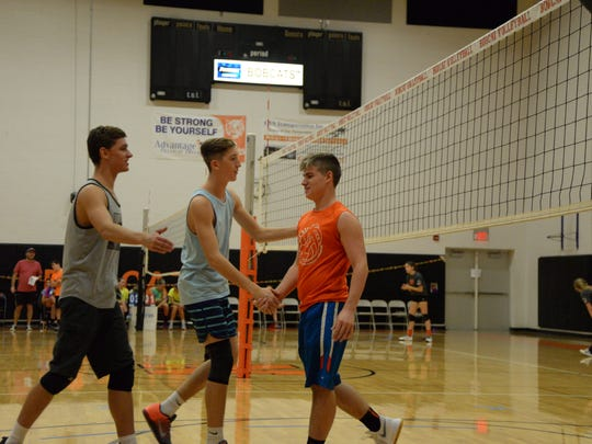 Players from both teams shake hands during the Silence Ends Here Volleyball Tournament at Northeastern High School on Sunday. The gesture of sportsmanship echoed a larger statement made throughout the day - Look out and care for others.