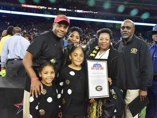 Grambling coach Broderick Fobbs is pictured with his wife, Kim, center, his two daughters, his mother, Sheila, right, and father, Lee, far right, at the 2016 SWAC championship game in Houston.