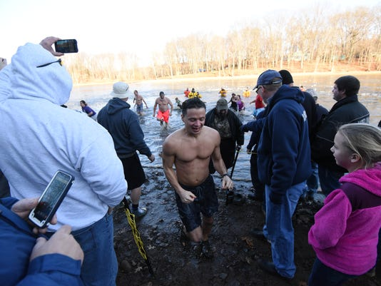 Polar Bear Dip: Cold for a Cure at Charles Mill Lake #stock  Park