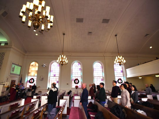 The congregation sing during Sunday service, photographed at Presbyterian Church of Tenafly in Tenafly on Jan 8th, 2017. Gay Willis performed in a Phantom of the Opera as Christine in 1994 and in Showboat in 1996.