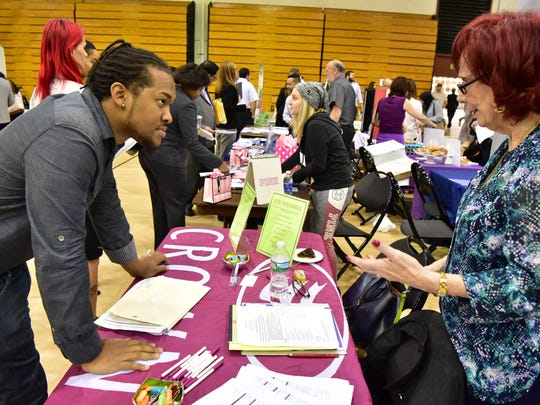 Job seeker Daniel Montaque of Hackensack talks to employer Marie Napoli of Crowne Plaza Saddle Brook at a job fair in Paramus in October.