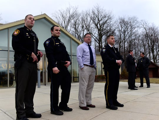Law enforcement officers listen to protesters at Terra
