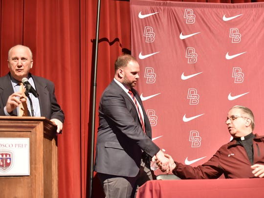 Assistant Principal of Academics Robert Fazio, left, speaks, while the new head coach Mike Teel shakes hands with Fr. James Heuser at the press conference in Ramsey, Feb. 16, 2017. Teel was named as the replacement for longtime coach Greg Toal.