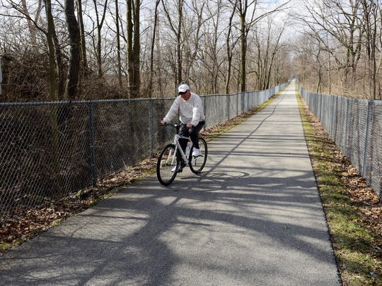 Stephen Holman of Fremont rides his bike on the trail at Walsh Park in Fremont.