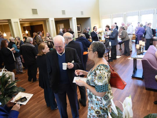 Residents, staff and supporters mingle at the new Parker