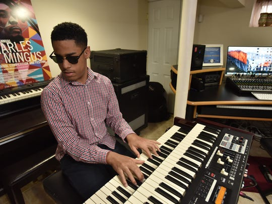 Whitaker, who was born blind, began playing piano when