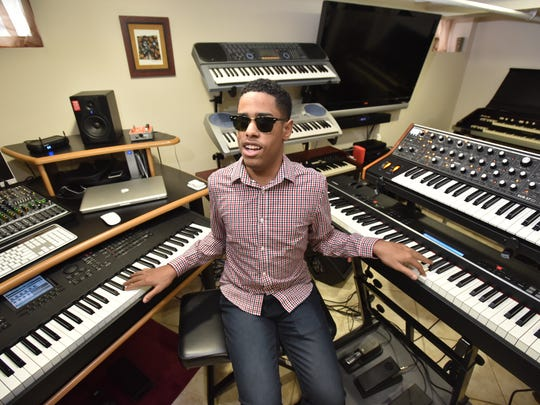 Matthew Whitaker of Hackensack, a 15-year old piano prodigy, with some of his keyboards
