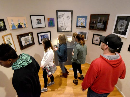 The Mansfield Art Center's walls were full with the 2017 Annual regional High School Exhibition on Saturday. The exhibit runs until April 16th.