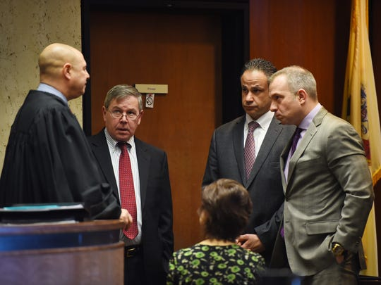 ( L to R),  Superior Court Judge Michael Ravin, Essex County assistant prosecutors Brian Matthews and Ralph Amirata, and defense attorney Michael Rubas hold a sidebar during the fifth day of the trial of Basim Henry in the Essex County Superior Court in Newark on Thursday, March 23, 2017. Henry is one of four men charged in the murder of Dustin Friedland during a Dec. 15, 2013 carjacking at the Mall at Short Hills.