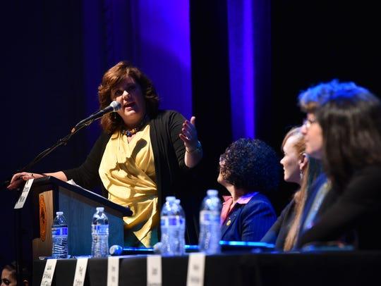 Moderator Donna Miller asks panelists a question.