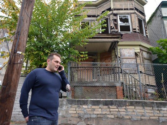 Developer Charles Florio checking out Paterson properties in 2014.
