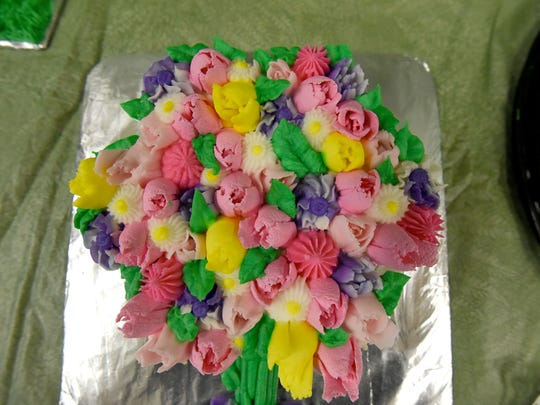 A cupcake bouquet created by Cobblestone Confections.